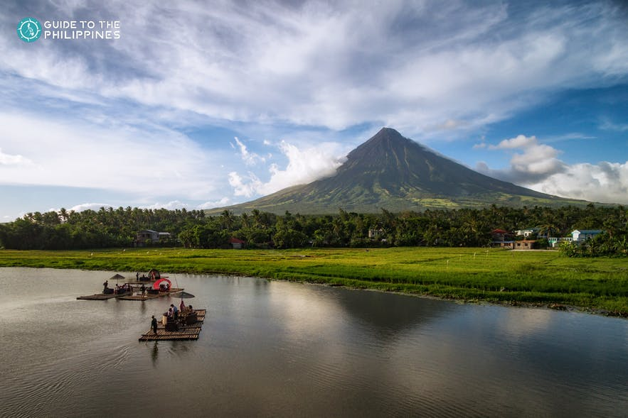 Tourists float on rafts on Sumlang Lake near Mayon Volcano