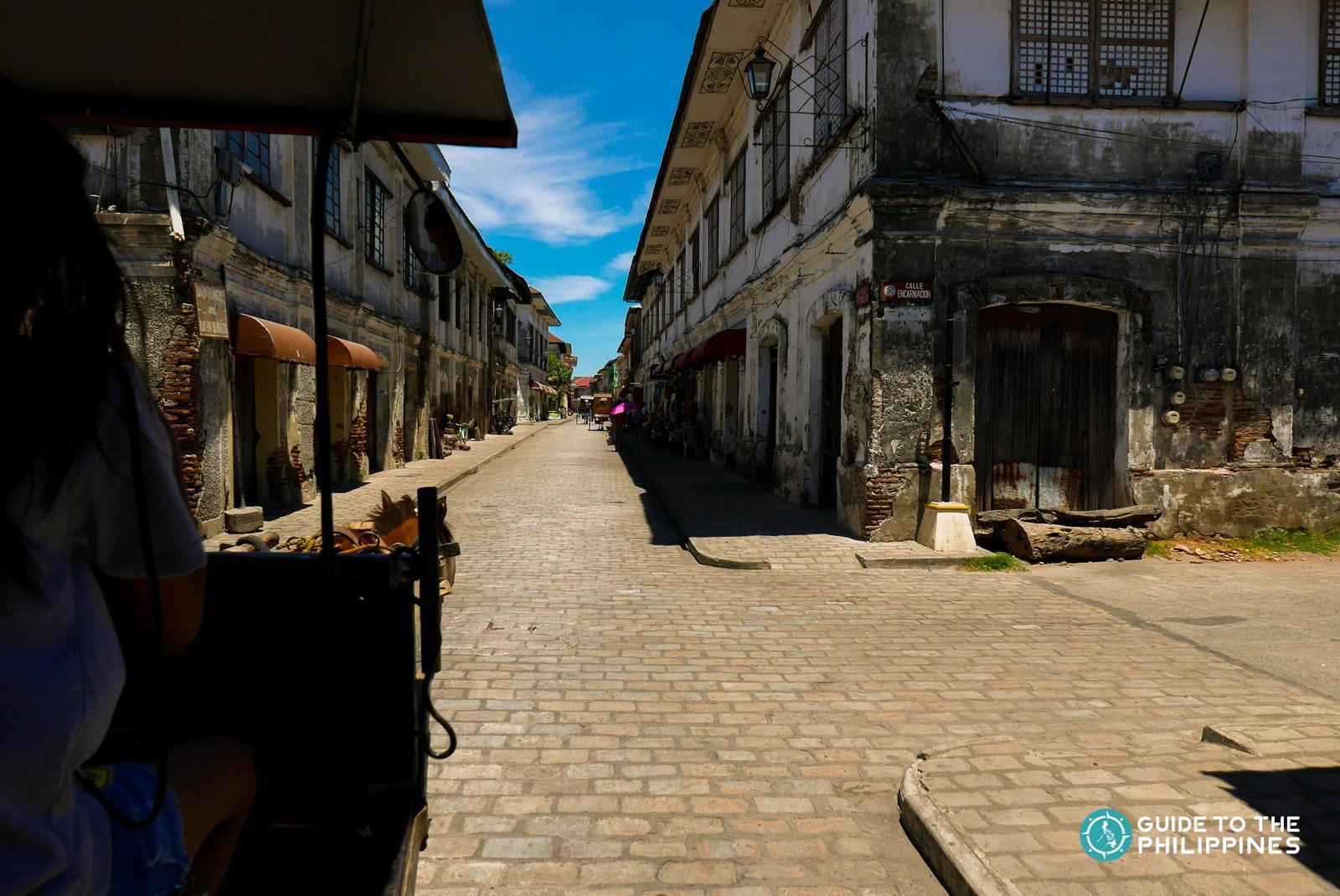 Riding a calesa while exploring Calle Crisologo in Vigan