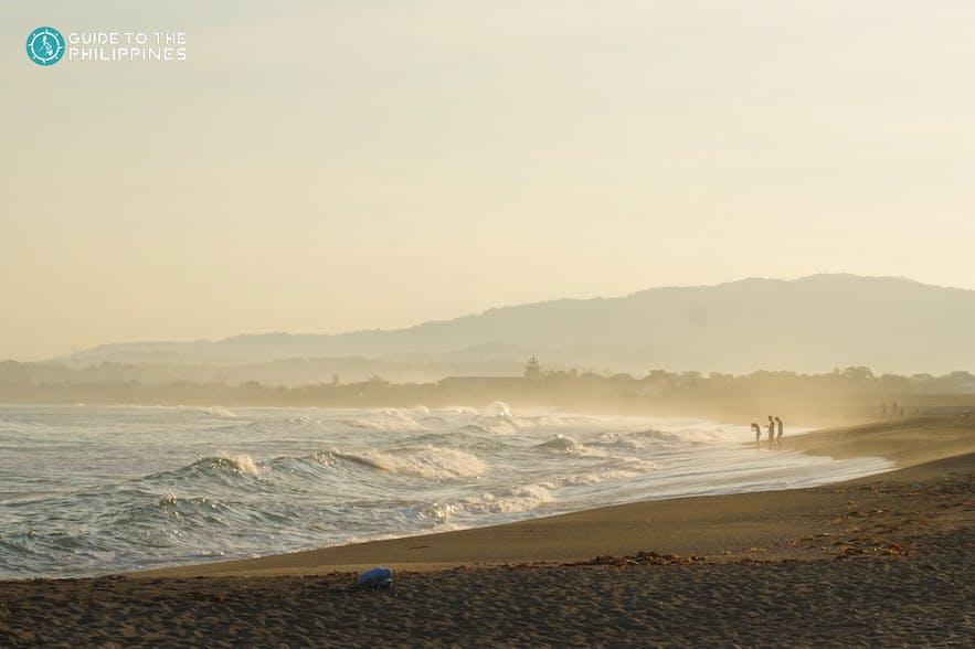 Early morning on Urbiztondo Beach in San Juan