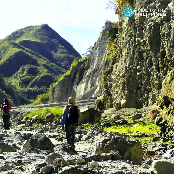 Trekking the rocky path going to the peak of Mt. Pinatubo