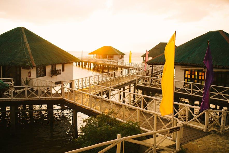 Cottages in Stilts Calatagan Beach Resort during sunset
