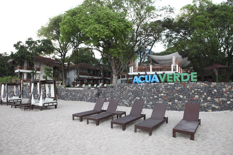 Lounge chairs on the beachfront of Acuaverde Beach Resort