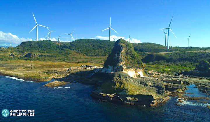 View of windmills in Kapurpurawan Rock Formation in Ilocos