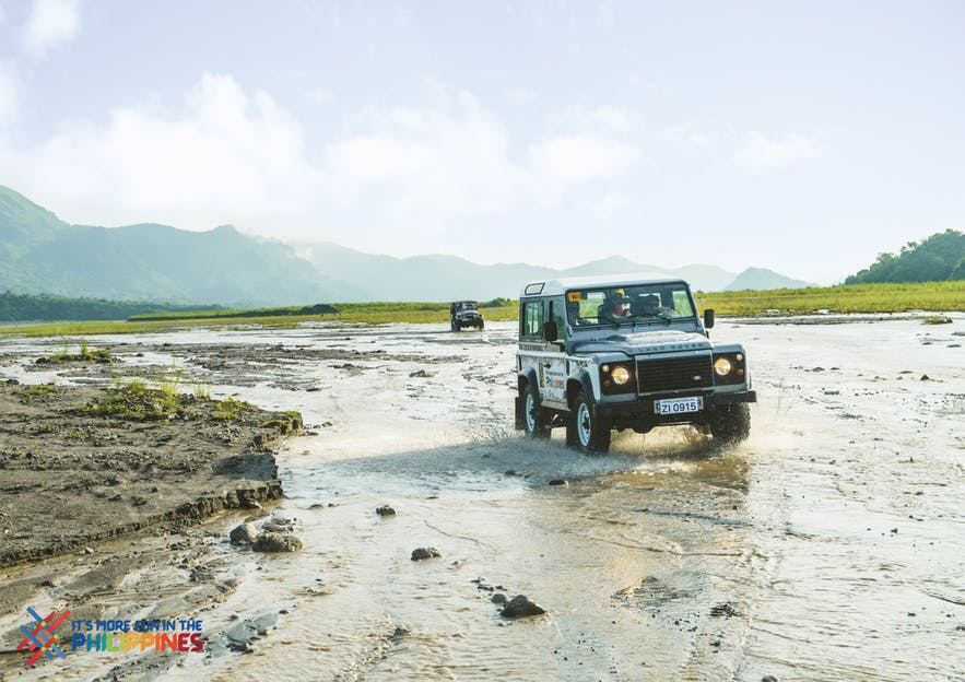 Hikers ride 4x4 cars across Mt. Pinatubo's fields