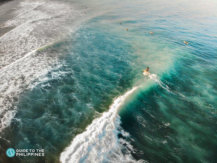 Surfer rides a wave in La Union