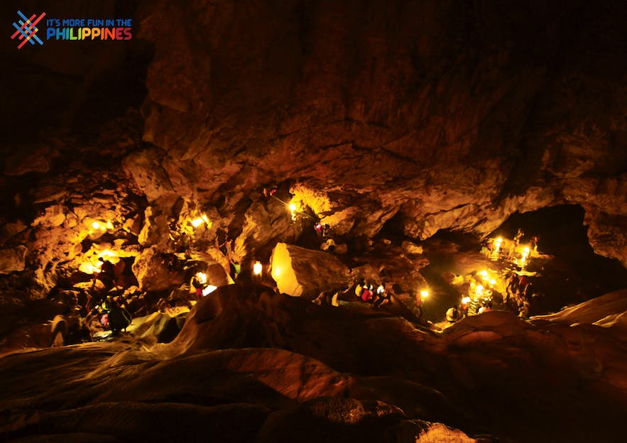Travelers inside Sumaguing Cave