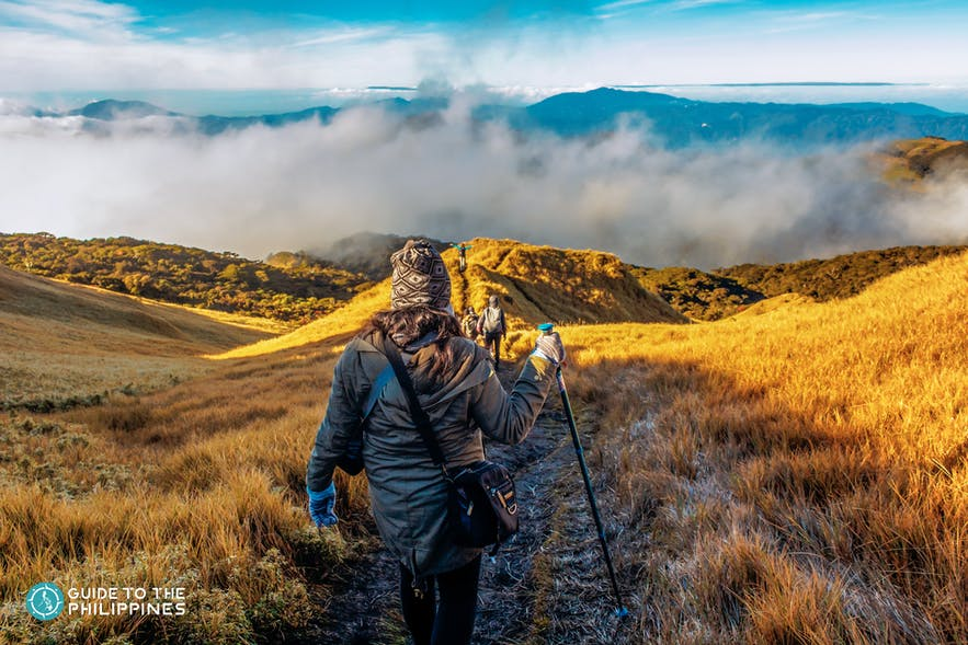 Woman hikes up Mt. Pulag