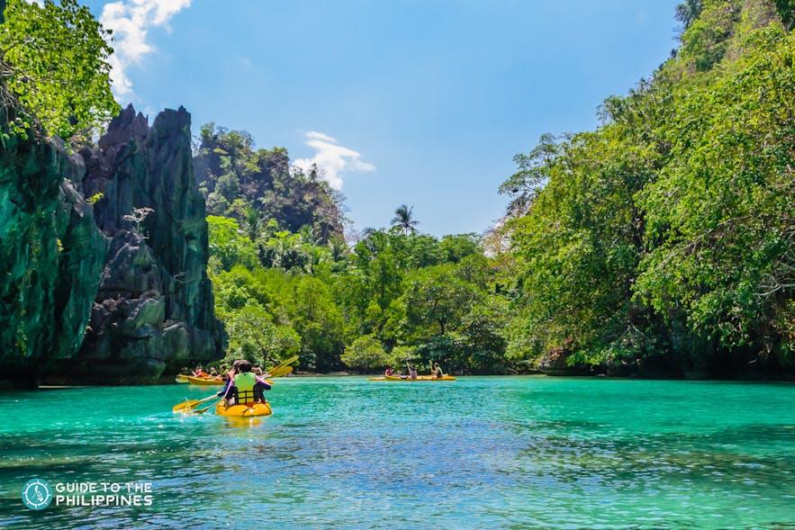 People kayaking in Big Lagoon, Palawan