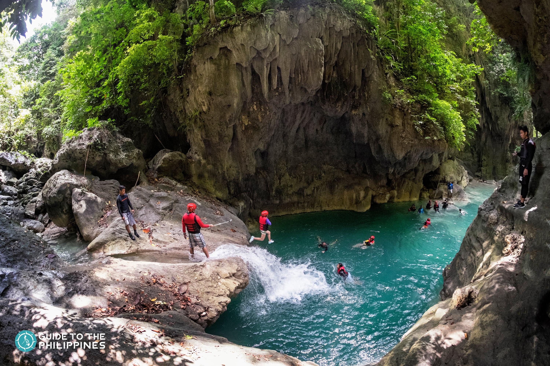 Tourists jumping in Kawasan Falls