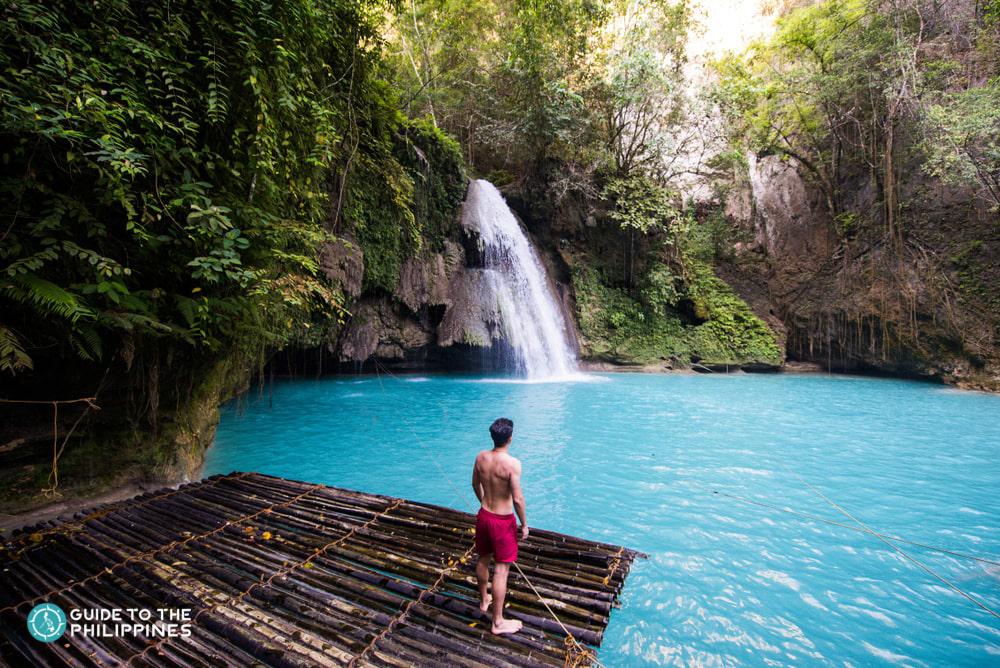 A man enjoying the view of Kawasan Falls in Cebu