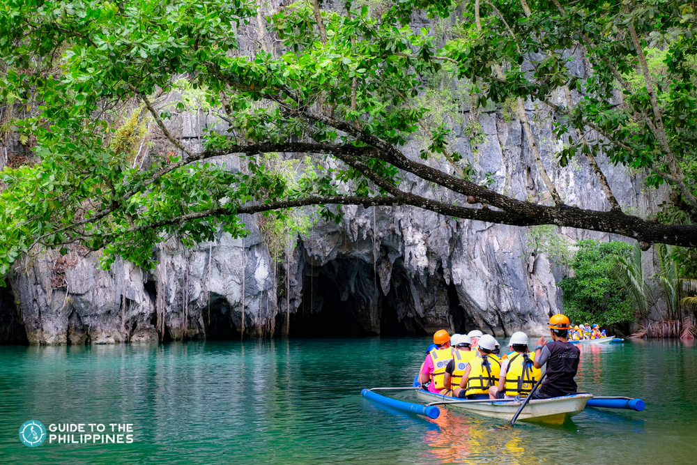 A boat of tourists going inside Puerto Princesa Underground River in Palawan