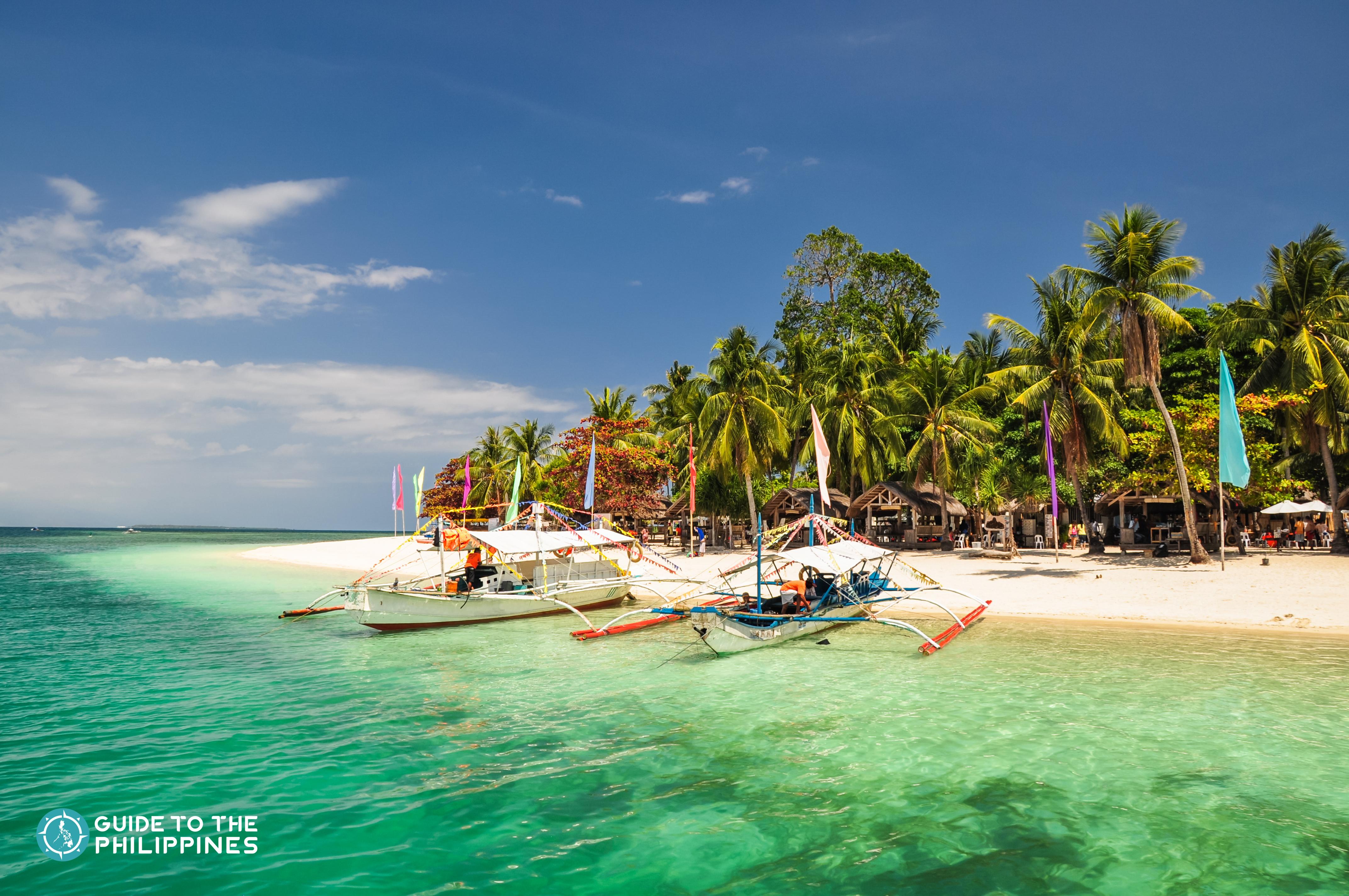 Boats docked on the shore of Honda Bay in Puerto Princesa Palawan