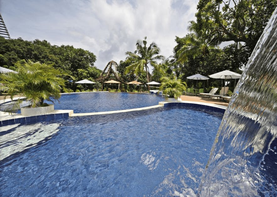 The pool area of Oldwoods by The Sea Nature Resort