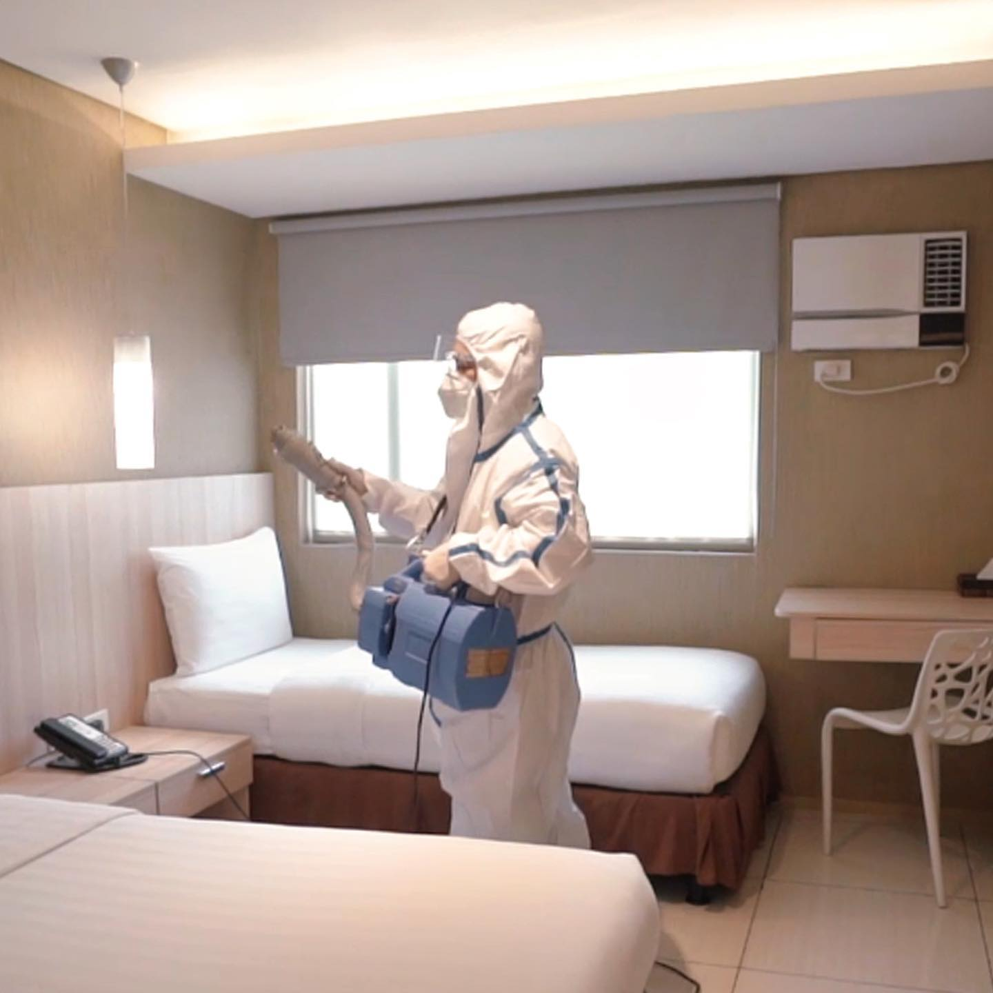 Disinfecting the room at Hotel 101 in Manila
