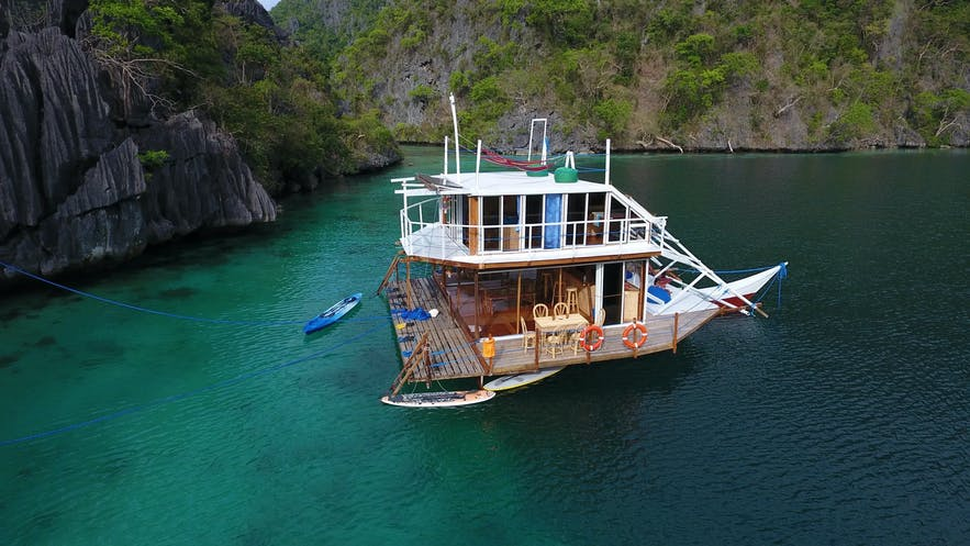 The Paolyn Houseboat in a lagoon in Palawan