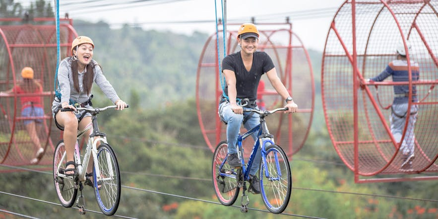 Tourists trying Eden Nature Park's skycycles