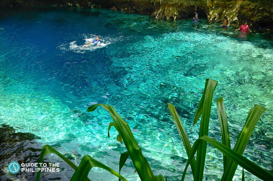 People swimming in Enchanted River, Surigao del Norte