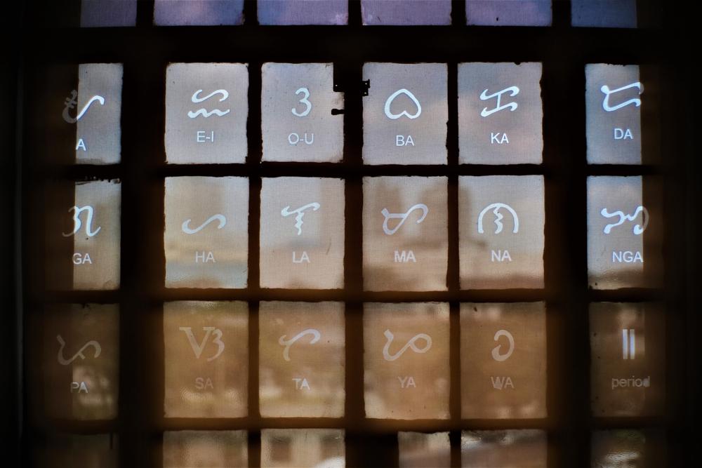 Baybayin characters on a window