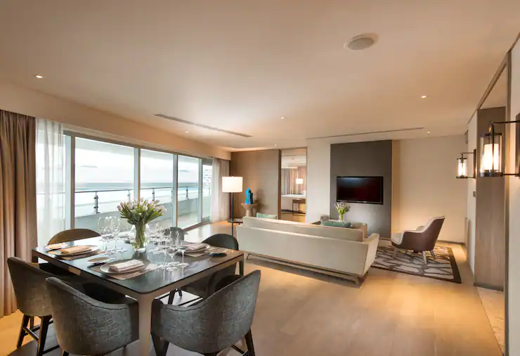 Enjoy the living room of your double bedroom in Conrad Hotel