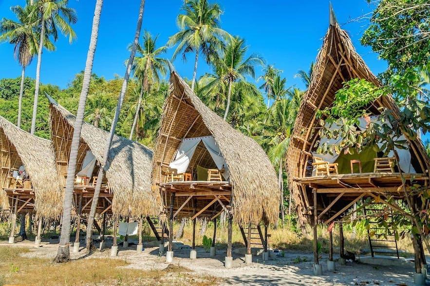 The beachside nipa huts of The Island Experience