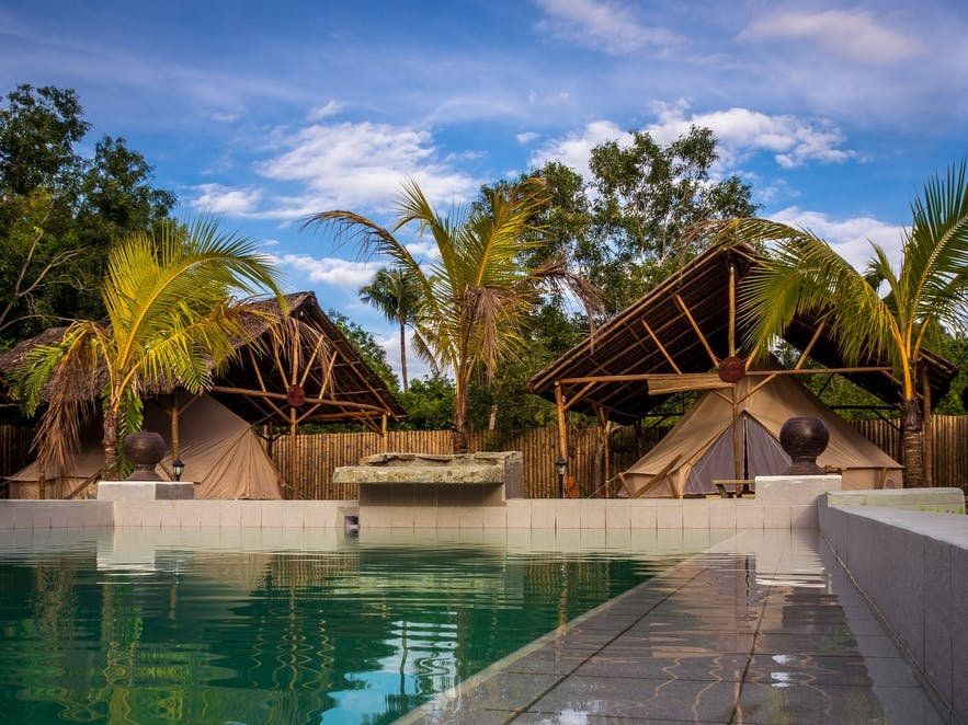 Poolside tents of Glamping Alona Resort
