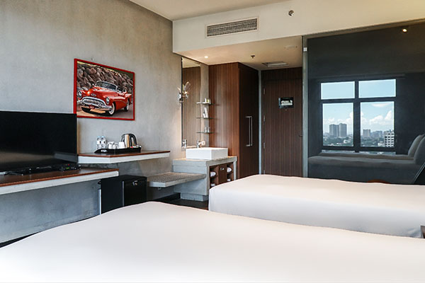Twin beds inside a superior room in B Hotel in Quezon City