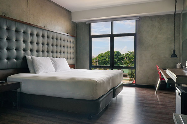 King sized bed inside a superior room in B Hotel