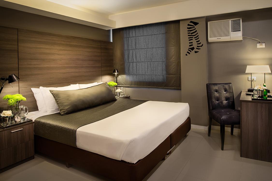 Inside a standard bedroom in Astoria Greenbelt