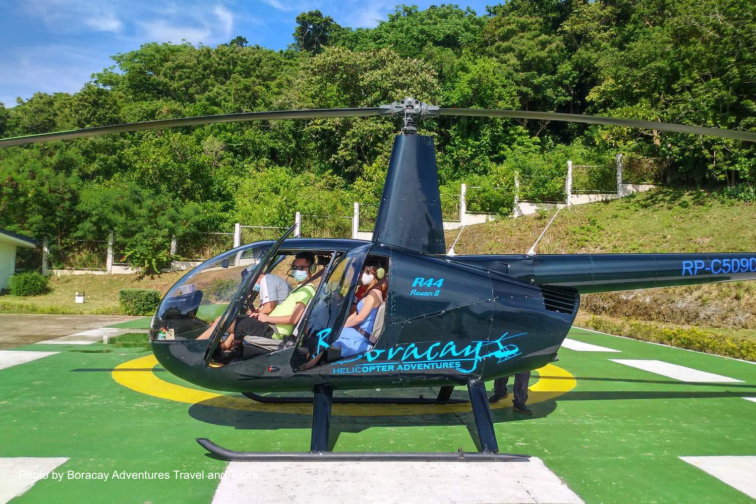 Tourists riding a helicopter to explore Boracay Island