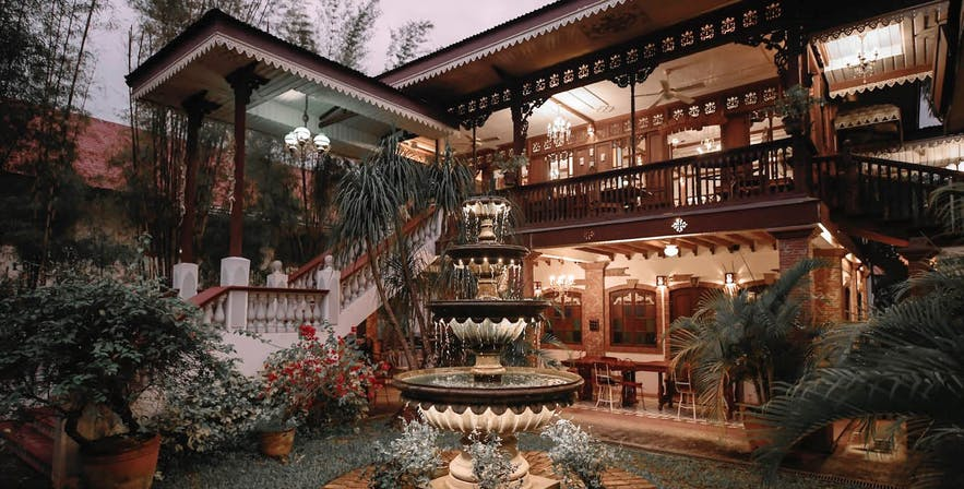 A fountain by Sulyap Gallery and Cafe's Casa San Juan