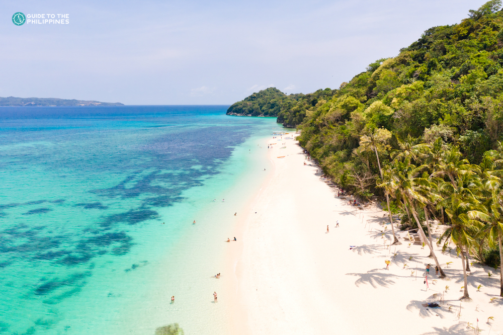 Clear blue waters and white sand at Puka Beach in Boracay