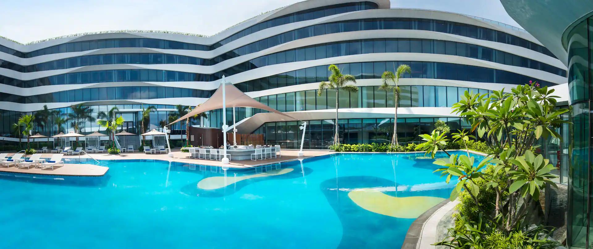 Panorama view of Conrad Hotel Manila's outdoor pool