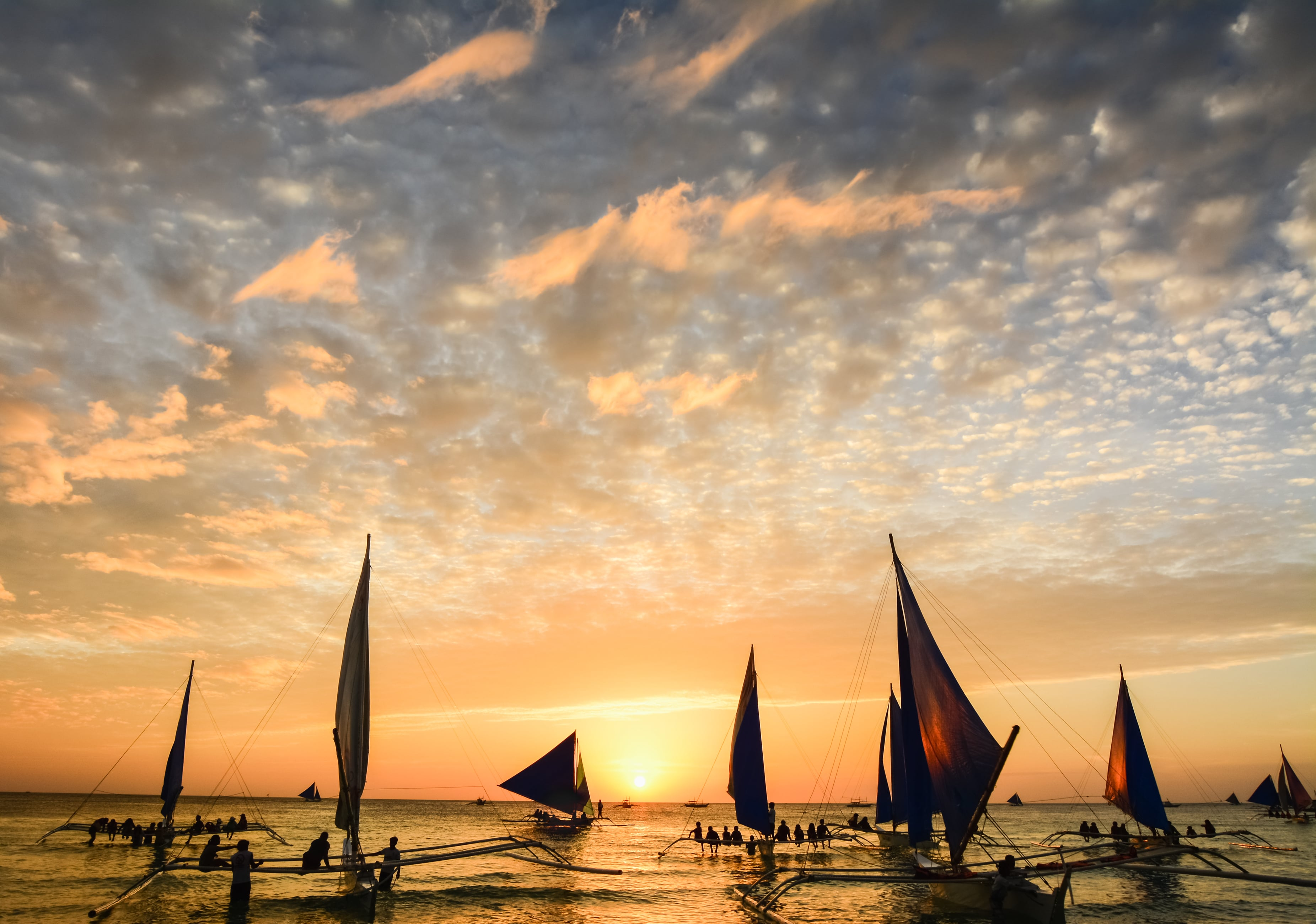 Relaxing paraw sailing during sunset at Boracay