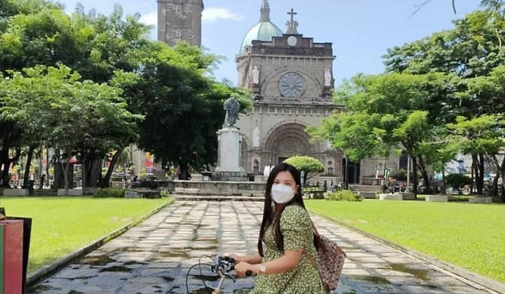 Tourist in our Eco-Friendly Bamboo Bike in Intramuros