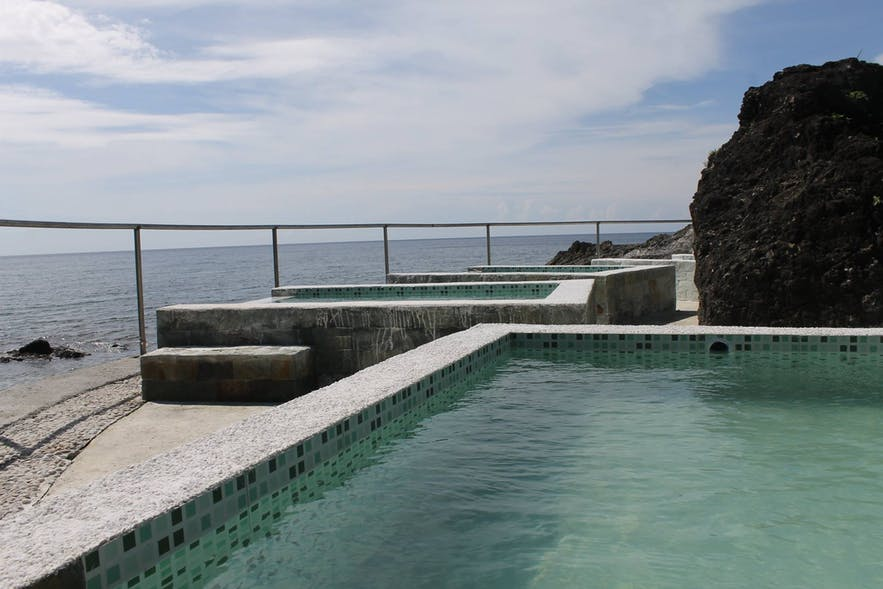 Sira-an Hot Spring and Health Resort's beachside pools