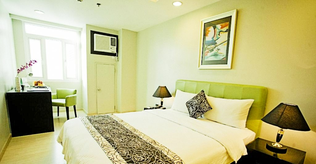 Inside the Deluxe Classic Room at The Exchange Regency Hotel