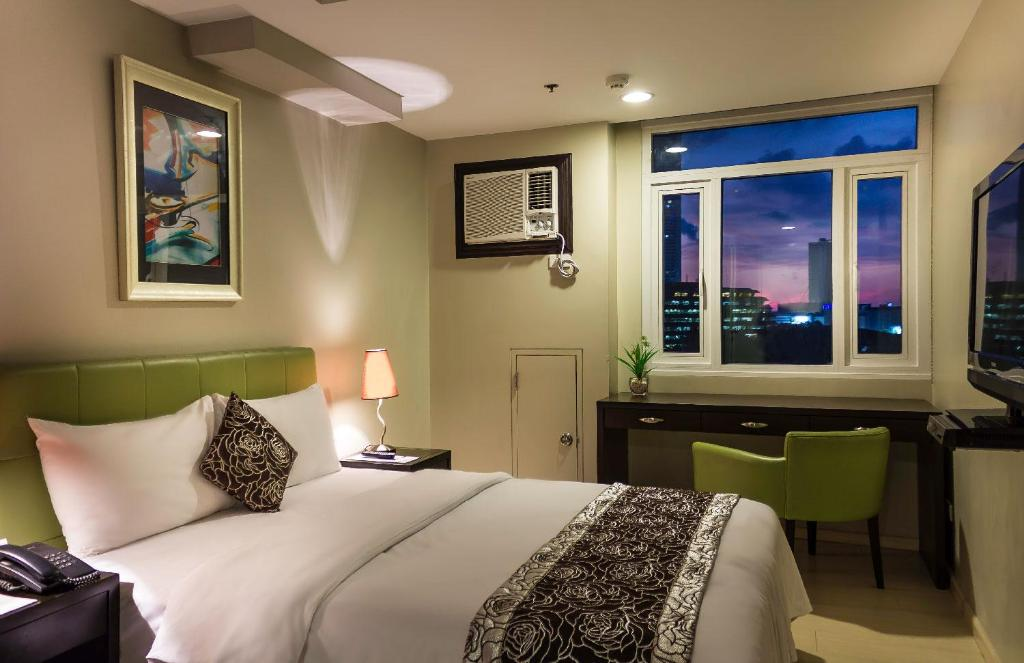Inside the Deluxe Classic Room at The Exchange Regency