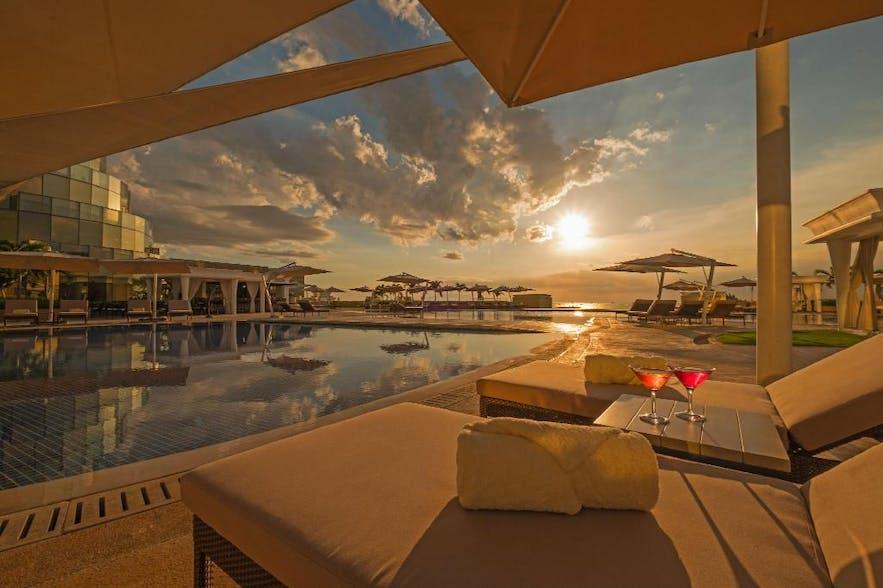 Okada Manila's poolside at sunset