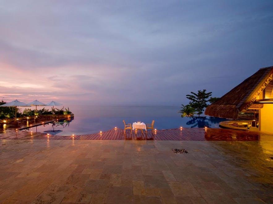 Romantic dinner by Eskaya Beach Resort & Spa's pool