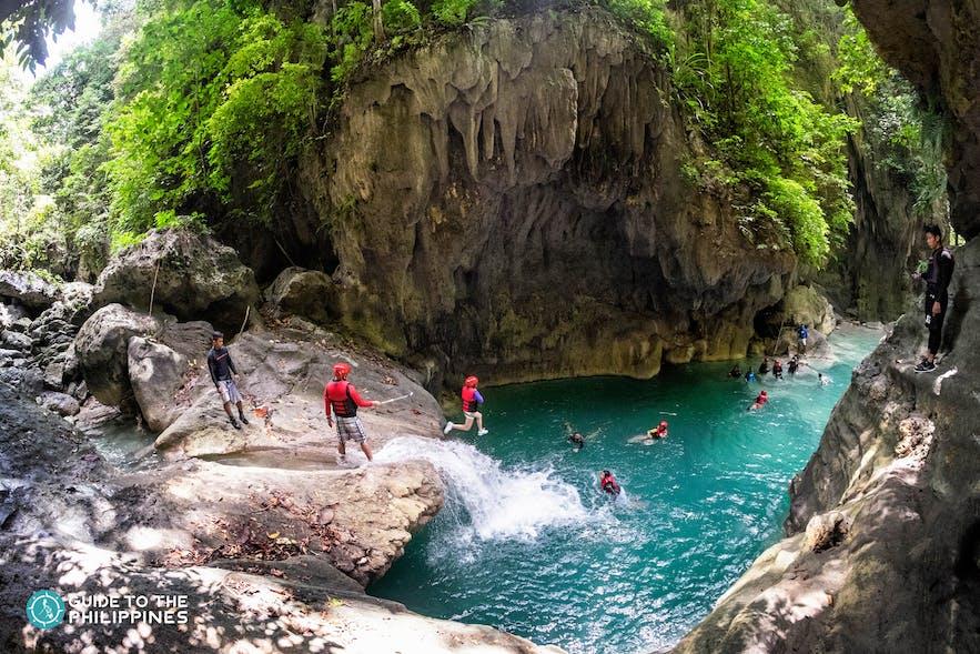 Tourists canyoneering in Badian, Cebu