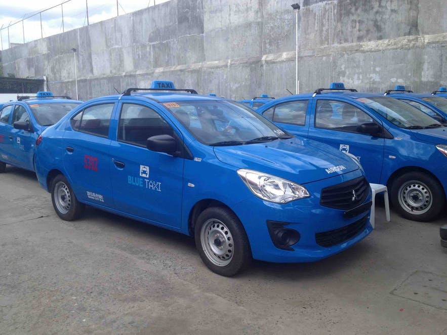 A blue taxi in Davao