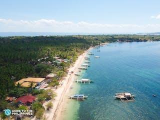 Aerial view of Maniwaya Island's shoreline.jpg